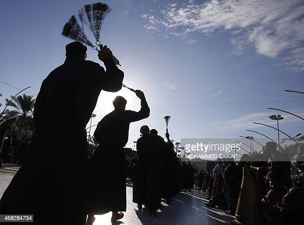 Iraqi Shiite Muslim worshipers selfflagellate near the shrine of Imam Abbas during rituals to commemorate Ashura in Karbala 50 miles south of Baghdad...