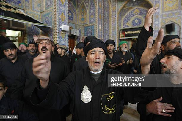 Iraqi Shiite Muslims beat their chests during a Ashura mourning ritual in the holy city of Karbala about 110 kms south of the Iraqi capital Baghdad...