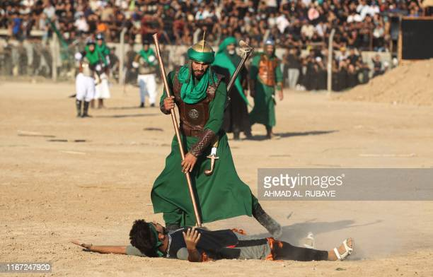 Iraqi Shiite Muslims costumes re-enact events of Ashura, in Baghdad's predominantly Shiite Sadr City, on September 10, 2019. - Ashura is commemorated...