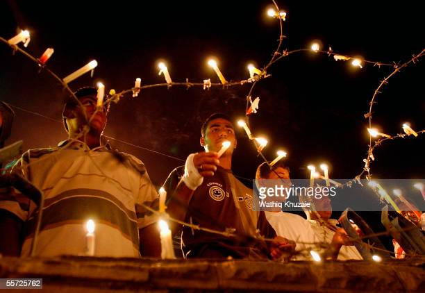 Iraqi Shiite pilgrims place candles on barbered wire September 19 2005 in the city of Karbala 70 miles south of Baghdad Iraq Hundreds of thousands of...