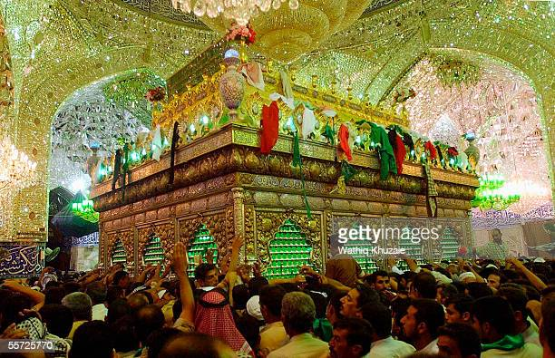 Iraqi Shiite pilgrims touch Imam Abbas' tomb September 19 2005 in the city of Karbala 70 miles south of Baghdad Iraq Hundreds of thousands of Iraqi...