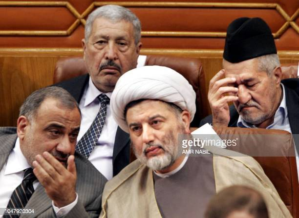 Iraqi Shiite Sheikh Humam Hammoudi who chairs the deligations of the Supreme Council for the Islamic Revolution in Iraq listens to Iraqi Vice...