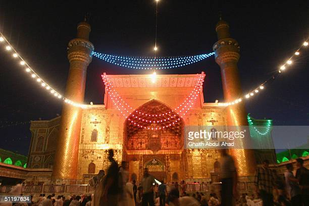 Iraqi Shiite supporters of the radical cleric Moqtada alSadr walking in the shrine of Imam Ali on August 17 2004 in Najaf Iraq Iraqi political and...