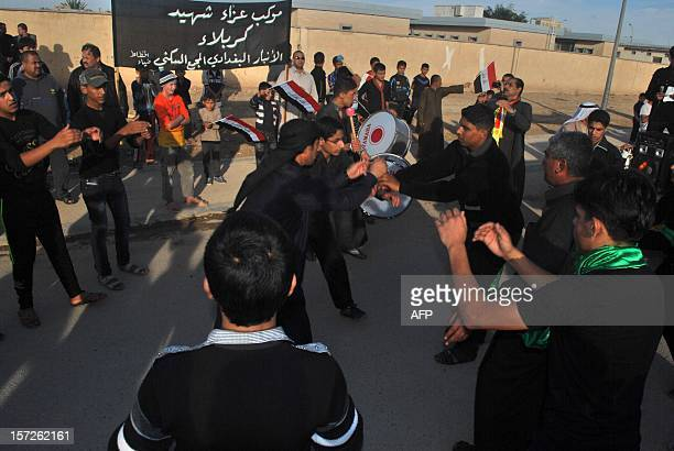 Iraqi Shiite take part in march to mark Ashura in the Iraqi town of Baghdadi in the Anbar province on November 30 2012 The march saw the...