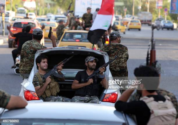 Iraqi Shiite tribesmen parade with their weapons in central Baghdad's Palestine Street as they show their willingness to join Iraqi security forces...