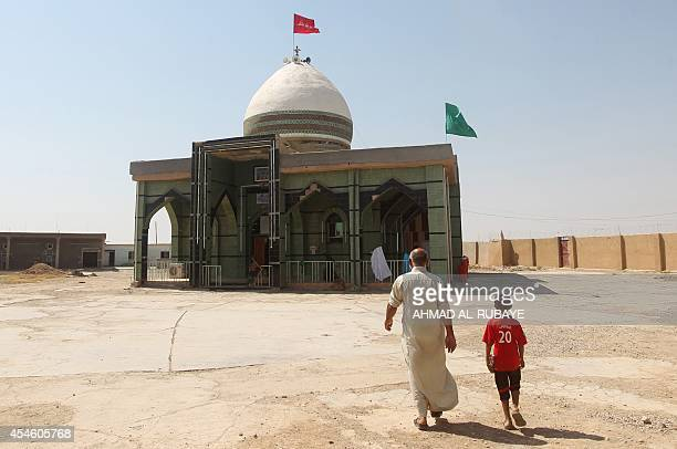 Iraqi Shiite Turkmen worship at a holy site in Amerli on September 3 that is dedicated to Hasan ibn Ali the second of the twelve Shiite Imams....