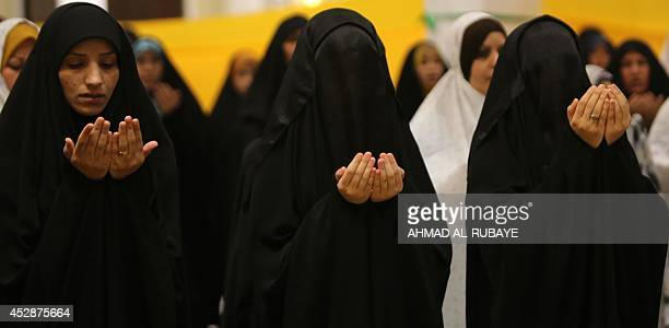 Iraqi Shiite women perform the Eid alFitr prayer at the headquarters of the Shiite Muslim Supreme Iraqi Islamic Council in Baghdad on July 29 as...