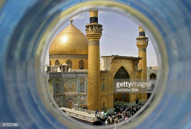 Iraqi Shiite worshippers gather at the golden Shrine of Imam Ali during a religious ceremony to mark the death of Prophet Mohammed at the holy city...