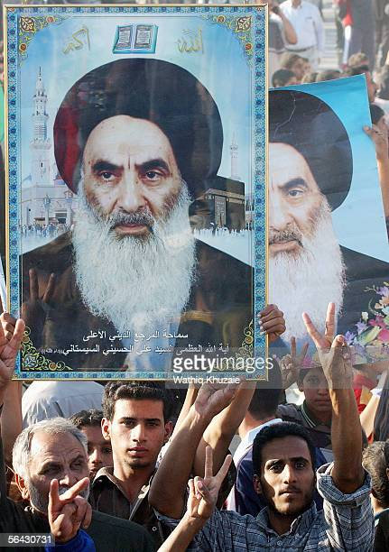 Iraqi Shiites carry pictures of Grand Ayatollah Ali al-Sistani and chant slogans during a demonstration, just one day before the country's landmark...