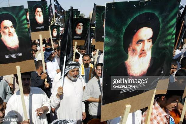Iraqi Shiites carry poters of Grand Ayatollah Ali al-Sistani as they take part in a protest 21 June 2007 in the holy city of Najaf, against the...