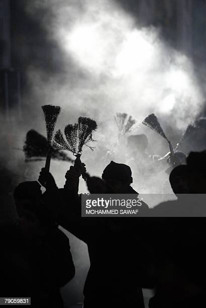 Iraqi Shiites flail themselves as they perform a religious procession in preparation to commemorate the martyrdom of Imam alHussein in the shrine...
