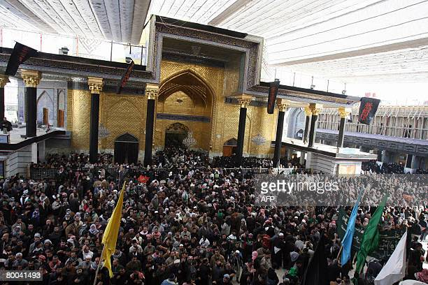 Iraqi Shiites gather at the Shrine of Imam Hussein in Karbala during the mourning ceremony of Arbaeen on February 28 2008 Around nine million Shiite...