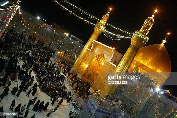 Iraqi Shiites gather outisde Imam Ali's shrine in the holy city of Najaf 07 January 2007 on the eve of Eid alGhadir The festival commemorates the...