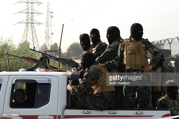Iraqi Shiites of the Mahdi Army militia wearing black balaclava face masks and loyal to cleric Moqtada alSadr vow to fight ISIS in a show of strength...