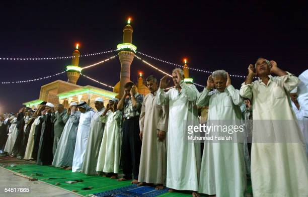 Iraqi Shiites pray at Imam Kadhim Shrine after attending funeral services of the stampede victims September 4 2005 in Baghdad Iraq Funeral services...
