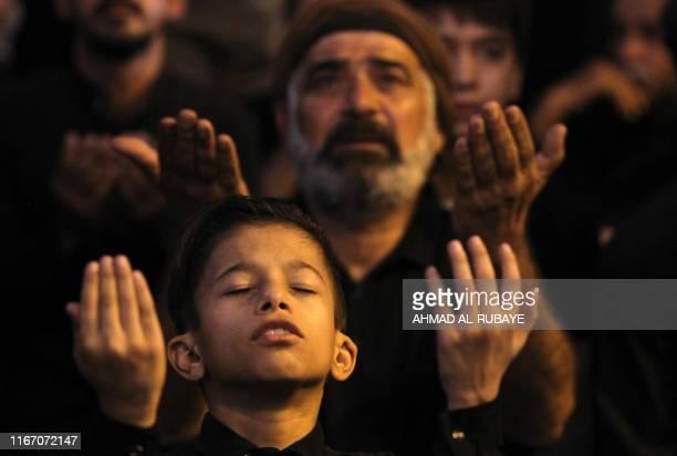 TOPSHOT Iraqi Shiites pray in the capital Baghdad's mostly Shiite neighbourhood of Kadhimiya on the eve of Ashura on September 9 2019 The religious...