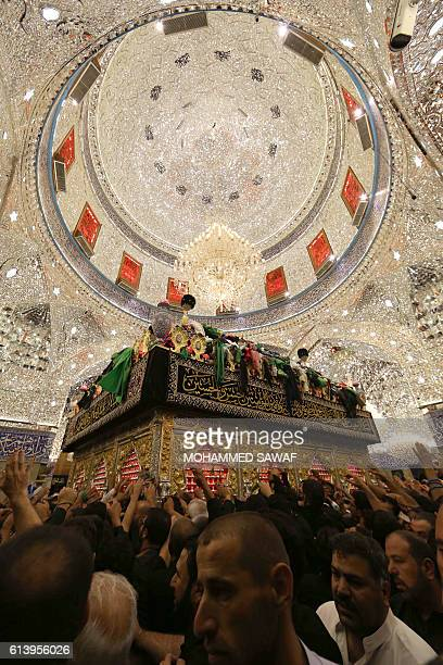 Iraqi Shiites pray inside the Imam Abbas shrine in commemorations on the tenth day of the mourning period of Muharram which marks the day of Ashura...