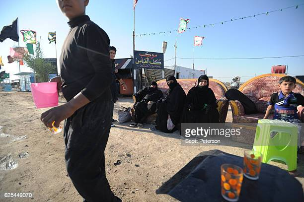 Iraqi Shiites rest along the route for millions of pilgrims in the annual religious ritual of Arbaeen which commemorates the 40th day after the death...