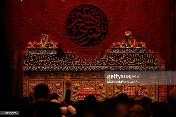 Iraqi Shiites take part in commemorations marking the mourning period of Ashura in the shrine of Imam Abbas on October 10 2016 in the holy city of...