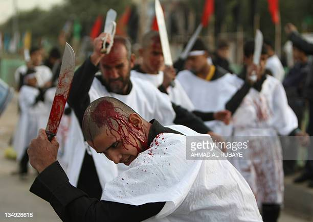 Iraqi Shiites use knives in a selfflagellation ritual in Baghdad on December 5 2011 during Ashura commemorations marking the 7th century killing of...
