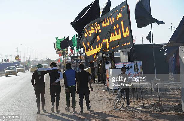 Iraqi Shiites walk the route for millions of pilgrims in the annual religious ritual of Arbaeen which commemorates the 40th day after the death of...