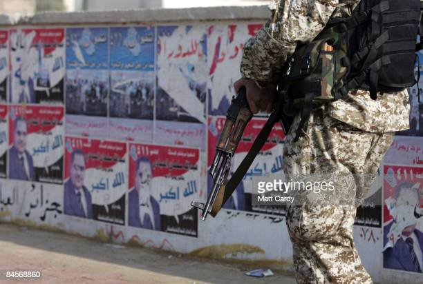 Iraqi soldier patrols outside a polling station in central Basra on January 31 2009 in Basra Iraq Iraqis are going to the polls today to elect...