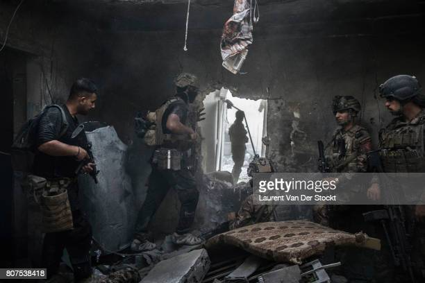 Iraqi soldiers advance through a hole they created in alNuri mosque district of Mosul's Old City on June 29 2017 The Iraqi Army Special Operations...