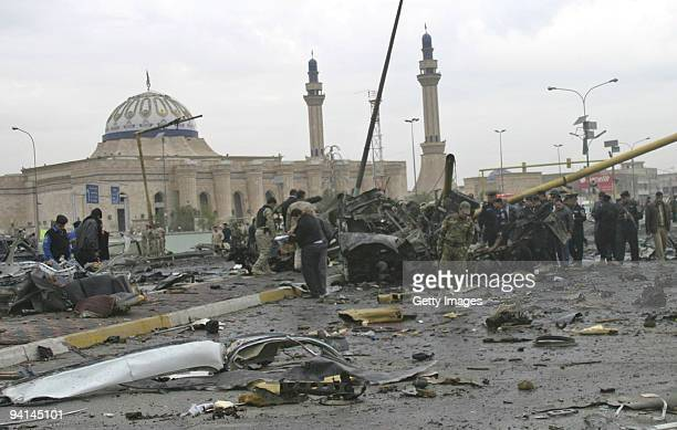 Iraqi soldiers are seen at the site of a car bomb explosion on December 8 2009 in Baghdad Iraq A series of five bombings in Baghdad today has killed...