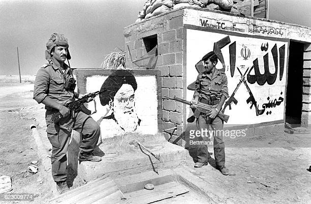 Iraqi soldiers at the Khorramshahr police station pose near a portrait of Ayatollah Khomeini that was on the wall of a fort the Iraqis captured. This...