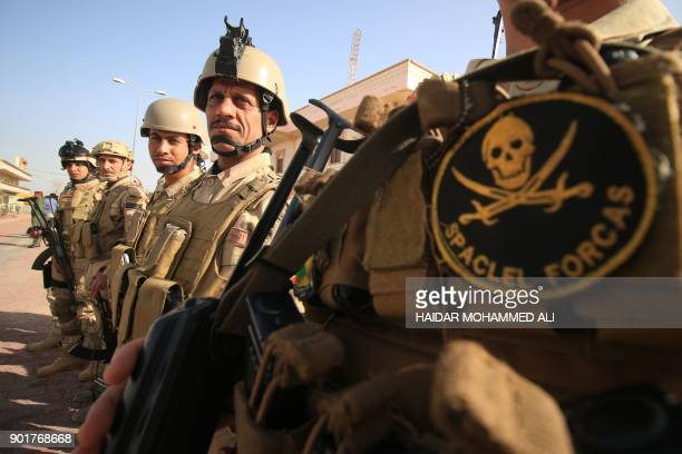 Iraqi soldiers attend a ceremony marking Iraq's 97th Army Day on January 6 in the southern city of Basra ALI