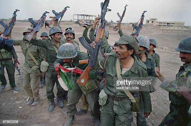 Iraqi soldiers celebrate their victory over Iran 20 April 1988 in the strategic Faw peninsula of southeast Iraq that was partly occupied by Iranian...