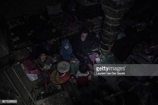 Iraqi soldiers discover a woman and two children in alNuri mosque complex on June 29 in Mosul Iraq The Iraqi Army Special Operations Forces and...