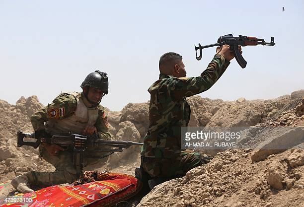 Iraqi soldiers fire towards Islamic State group positions in the Garma district of Anbar province west of the Iraqi capital Baghdad on May 19 2015...