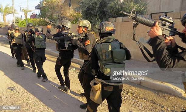 Iraqi soldiers from the elite counterterrorism service clear an industrial area on the outskirts of Ramadi as they search for suspected Islamic State...