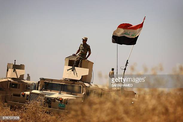 TOPSHOT Iraqi soldiers hold a position on the frontline on the outskirts of the Kurdishcontrolled area of Makhmur some 60 kilometres south of Mosul...