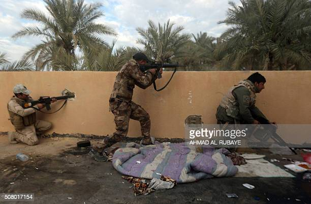TOPSHOT Iraqi soldiers keep position during clashes with jihadists from the Islamic State group in the suburbs of Ramadi the capital of Iraq's Anbar...