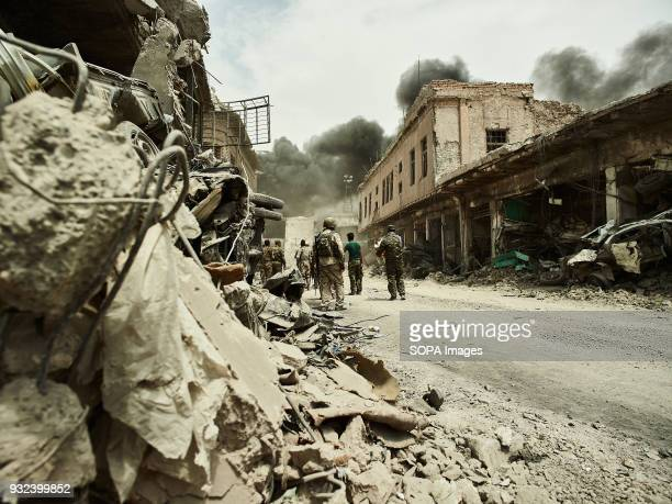 Iraqi soldiers look on as a coalition airstrike meets its target The city of Mosul in northern Iraq has been under Islamic State militants control...