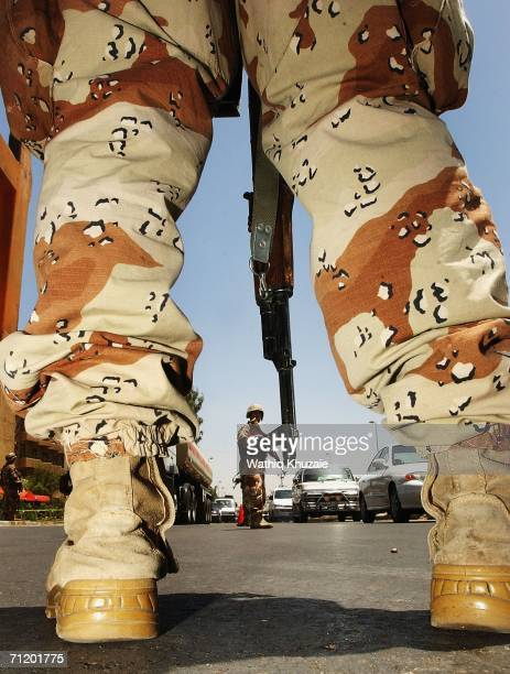 Iraqi soldiers man a check point on June 14 2006 in Baghdad Iraq Ten of thousands of Iraqi security forces launched a major security operation...