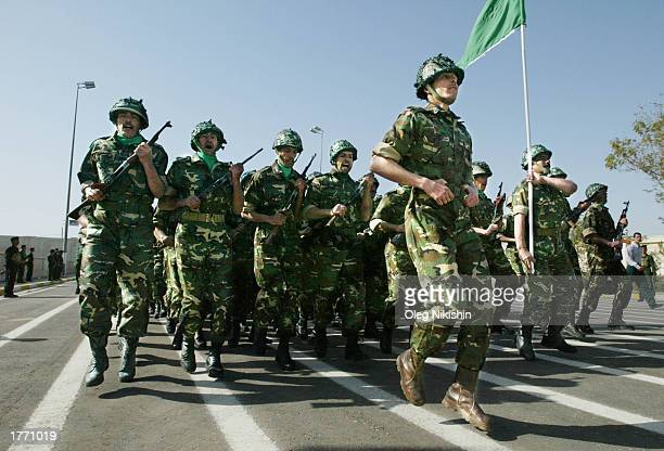 Iraqi soldiers march during a parade February 8 2003 in Tikrit Saddam Hussein's hometown Iraq Chief UN weapons inspectors landed in Baghdad for a new...
