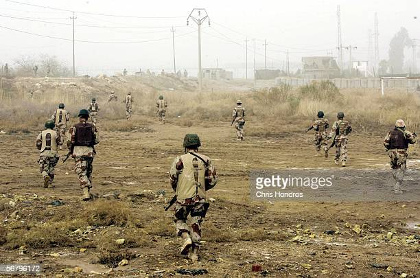 Iraqi soldiers march over fields back to their base after an urban sweep February 9 2006 in Ramadi Iraq Marines and Iraqi Army forces conducted...