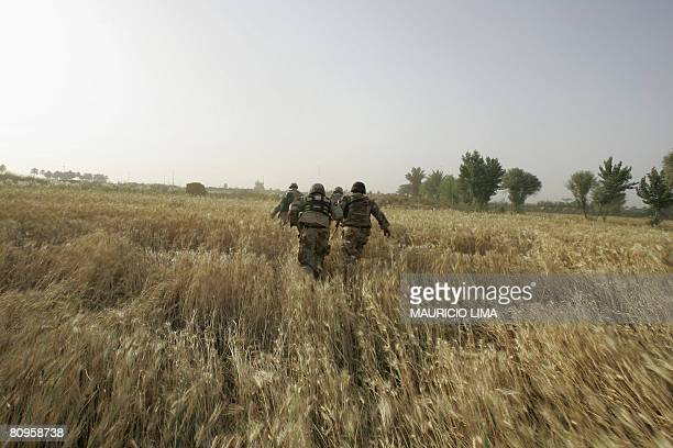 Iraqi soldiers of 1st Brigade, 3rd Battalion and US soldiers of 1st Battalion, 187th Infantry Regiment, 101st Airborne Division disembark a US...