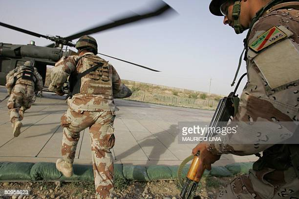 Iraqi soldiers of 1st Brigade, 3rd Battalion board a US Blackhawk helicopters for an air assault joint operation with US soldiers of 1st Battalion,...