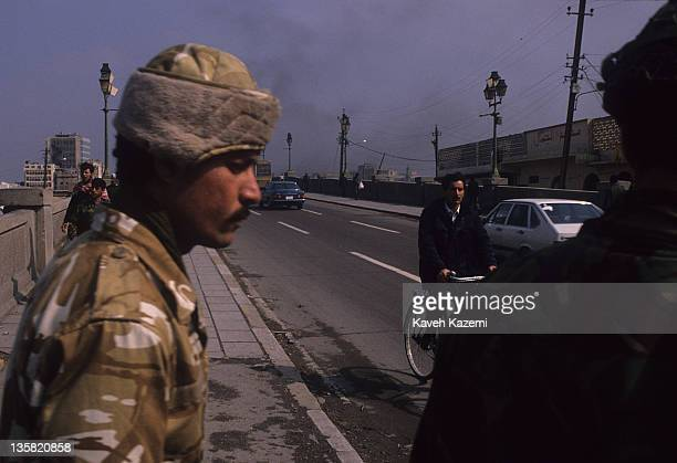 Iraqi soldiers on duty in central Baghdad during the Gulf War, 26th February 1991. People continue with their daily lives despite the bombardments...
