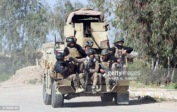 Iraqi soldiers patrol an area outside an army position where an attack was carried out by the Islamic State group jihadists in the Abu Ghraib area...