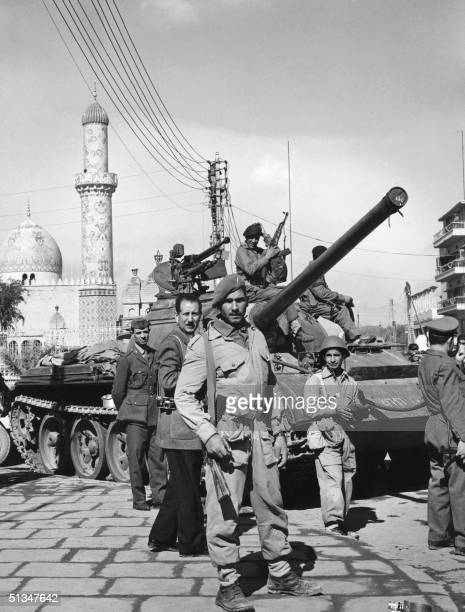 Iraqi soldiers patrol downtown Baghad 08 February 1963 after members of the panArab Ba'ath party led a successful coup d'etat against the brigadier...