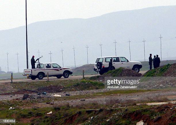 Iraqi soldiers patrol the border area of a 'no fly' zone March 4 2003 which is located approximately half a mile from the village of Kalak Northern...