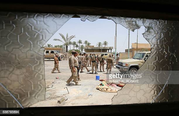 TOPSHOT Iraqi soldiers patrol the streets of Saqlawiyah north west of Fallujah on June 8 during an operation to regain territory from the Islamic...