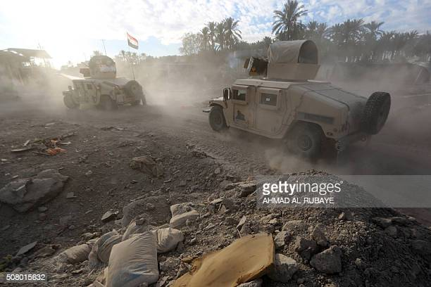 TOPSHOT Iraqi soldiers patrol the suburbs of Ramadi the capital of Iraq's Anbar province 120 kilometers west of Baghdad on February 2 2016 Iraqi...