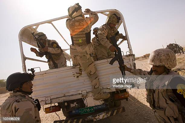 Iraqi soldiers prepare for a village clearance mission with US forces on June 11 2010 in Ali Ayun Diyala Province Iraq Iraq faces multiple challenges...