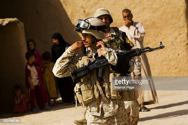 Iraqi soldiers search a village during a clearance operation on June 12, 2010 in Ali Juma, Diyala Province, Iraq. Iraq faces multiple challenges in...